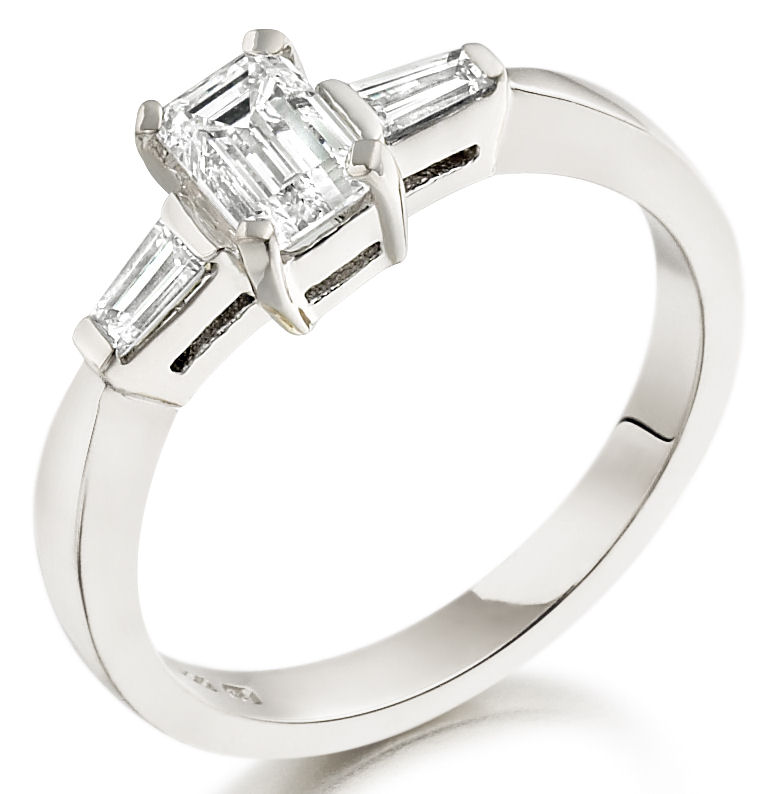 Single Stone Engagement Ring With Shoulders/Three Stone Ring for women in 18ct white gold with an emerald cut centre and two baguette diamonds-img1