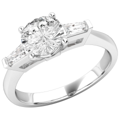 RD522W - 18ct white gold ring with a central round brilliant cut diamond, and a tapered baguette cut diamond on either side.