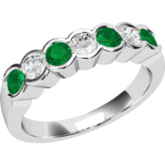 Emerald and Diamond Eternity Ring for Women in 9ct white gold with 4 round emeralds and 3 round brilliant cut diamonds, all in a rub-over setting