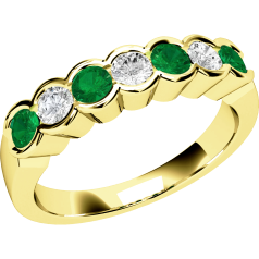 RDM184Y - 18ct yellow gold 7 stone emerald and diamond eternity ring