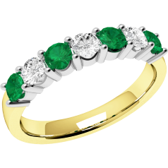 Emerald and Diamond Eternity Ring for Women in 9ct yellow and white gold with 4 round emeralds and 3 round brilliant cut diamonds in a claw setting
