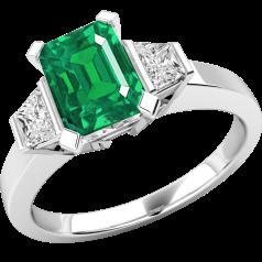 Smaragd und Diamant Ring für Dame in 18kt Weißgold mit einem achteckigen Smaragd und 2 Trapezschliff Diamanten