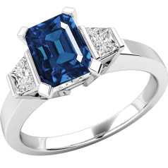Sapphire and Diamond Ring for Women in 18ct white gold with a 7 x 5mm octagon cut sapphire centre and trapezium cut diamond shoulders