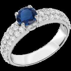 Saphir und Diamant Ring für Dame in 18kt Weißgold mit einem runden Saphir in Krappenfassung und mit runden Brillanten in Pavefassung auf den Schultern