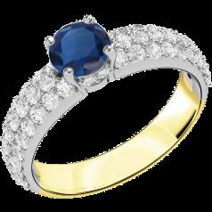 Saphir und Diamant Ring für Dame in 18kt Gelb und Weißgold mit einem runden Saphir in Krappenfassung und mit runden Brillanten in Pavefassung auf den Schultern
