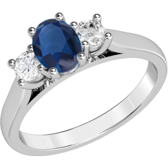 RDS493W - 18ct white gold ring with a claw set oval cut sapphire in the centre and with a round brilliant cut diamond on either side