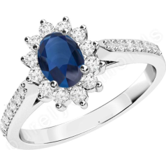 RDS563W - 18ct white gold cluster ring with an oval sapphire centre, surrounded by round brilliant cut diamonds and also down the shoulders.