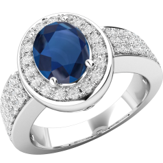 RDS569W - 18ct white gold cluster ring with an oval sapphire centre, surrounded by round brilliant cut diamonds and also down the shoulders.