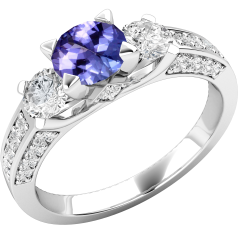 Tanzanite and Diamond Ring for Women in 18ct white gold with a round tanzanite centre and round brilliant cut diamonds either side and on the shoulders