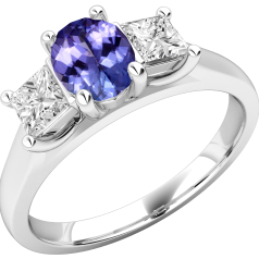 Tanzanite and Diamond Ring for Women in 18ct white gold with an oval cut tanzanite in the centre, and a princess cut diamond either side, all in a claw setting