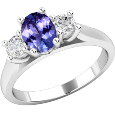 Tanzanite and Diamond Ring for Women in 18ct white gold with an oval cut tanzanite in claw setting in the centre with a round brilliant cut diamond on either side