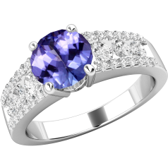 Tanzanite and Diamond Ring for Women in 18ct white gold with a round tanzanite centre and round brilliant cut diamonds in a channel and claw setting on the shoulders