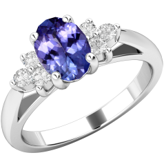 Tanzanite and Diamond Ring for Women in 18ct white gold with an oval tanzanite centre, and a cluster of 3 round brilliant cut diamonds on either side, all in a claw setting