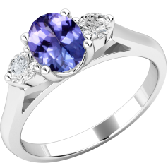 Tanzanite and Diamond Ring for Women in 18ct white gold with an oval cut tanzanite centre and a round brilliant cut diamond on either side, all in a claw setting