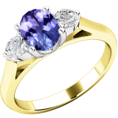 Tanzanite and Diamond Ring for Women in 18ct yellow and white gold with an oval cut tanzanite centre and a round brilliant cut diamond on either side, all in a claw setting