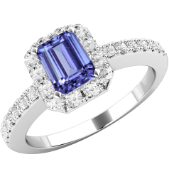 Tanzanite and Diamond Ring for Women in 18ct white gold with an emerald cut tanzanite centre and round brilliant cut diamonds surrounding it, all in a claw setting
