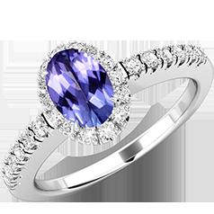 Inel Tanzanit si Diamante Dama Aur Alb 18kt cu un Tanzanit Oval si Diamante Rotunde