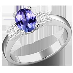 RDT718W-Inel cu Tanzanite si Diamante Dama Aur Alb 18kt cu 4 Diamante, cu un Tanzanite Central Oval si Diamante Forma Bagheta pe Margini